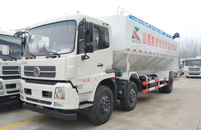 东风天锦10吨散装饲料车车头向左实拍图